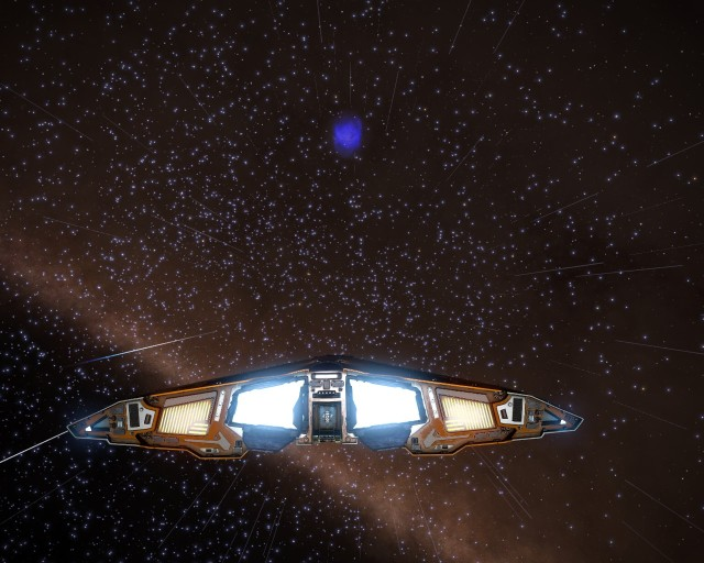 A blue planetary nebula in the distance.